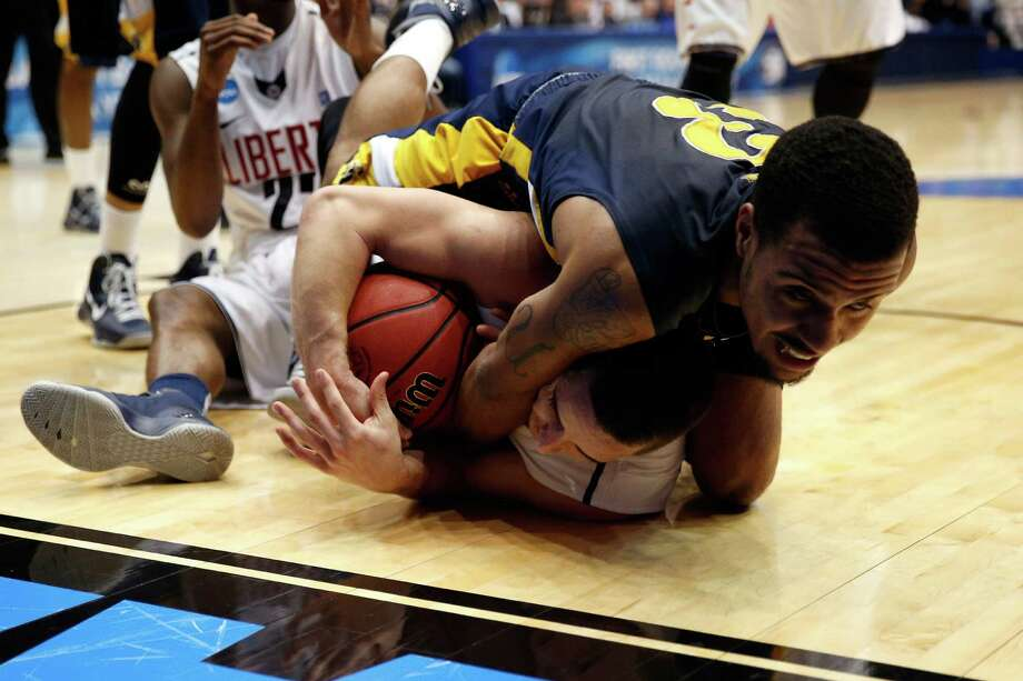 Jeremy Underwood #3 of the North Carolina A&T Aggies fights for the ball against John Caleb Sanders #33 of the Liberty Flames. Photo: Gregory Shamus, Getty Images / 2013 Getty Images