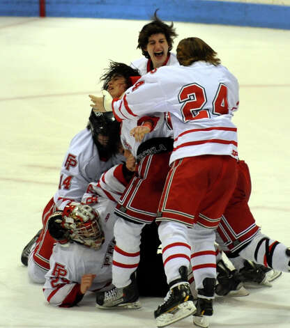 Fairfield Prep celebrates its win over Notre Dame of West Haven after CIAC Division I boys hockey final action at Ingalls Rink in New Haven, Conn. on March 19, 2013. Photo: Christian Abraham / Connecticut Post