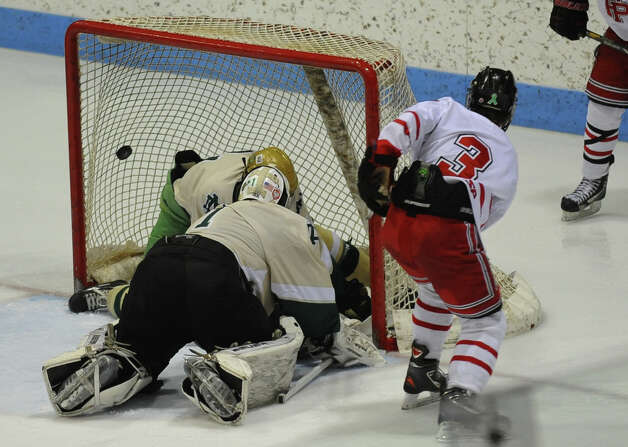 Fairfield Prep's #3 Matt Wikman gets the puck past Notre Dame of West Haven goalie #1 Paul Sliwinski, during CIAC Division I boys hockey final action at Ingalls Rink in New Haven, Conn. on March 19, 2013. Photo: Christian Abraham / Connecticut Post