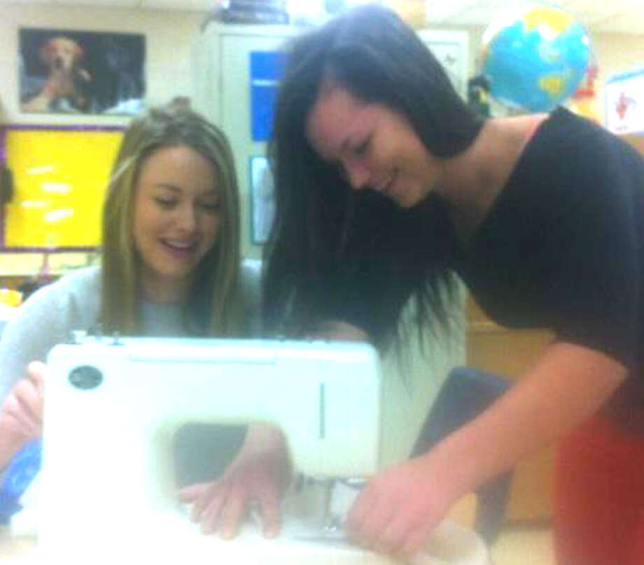 "Shepaug Valley High School's Emma Landegren, left, and Vanessa Wolfe work on designs for the May 26, 2013 benefit fashion show called ""A Walk To Remember.""  Courtesy of Vanessa Wolfe Photo: Contributed Photo"