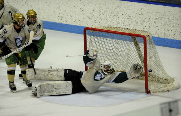 Notre Dame of West Haven goalie #1 Paul Sliwinski reaches out for the puck, during CIAC Division I boys hockey final action against Fairfield Prep at Ingalls Rink in New Haven, Conn. on March 19, 2013. Photo: Christian Abraham / Connecticut Post