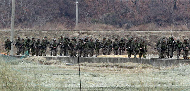 South Korean soldiers march during a military exercise near the border village of Panmunjom (DMZ) that separates the two Koreas since the Korean War, in Paju, north of Seoul, South Korea, Tuesday, March 19, 2013. The United States is flying nuclear-capable B-52 bombers on training missions over South Korea to highlight Washington's commitment to defend an ally amid rising tensions with North Korea, Pentagon officials said Monday.(AP Photo/Lee Jin-man) Photo: Lee Jin-man