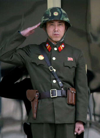 A North Korean soldier salutes to his senior soldiers, unseen, at the border village of Panmunjom, the demilitarized zone that has separated the two Koreas since the Korean War, in Paju, north of Seoul, South Korea, Tuesday, March 19, 2013. The United States is flying nuclear-capable B-52 bombers on training missions over South Korea to highlight Washington's commitment to defend an ally amid rising tensions with North Korea, Pentagon officials said Monday.  (AP Photo/Lee Jin-man) Photo: Lee Jin-man
