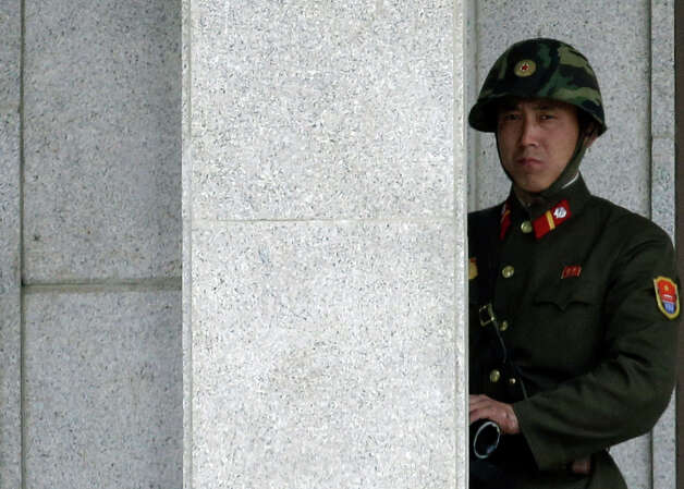 A North Korean soldier looks at the southern side at the border village of Panmunjom, the demilitarized zone that has separated the two Koreas since the Korean War, in Paju, north of Seoul, South Korea, Tuesday, March 19, 2013. The United States is flying nuclear-capable B-52 bombers on training missions over South Korea to highlight Washington's commitment to defend an ally amid rising tensions with North Korea, Pentagon officials said Monday.(AP Photo/Lee Jin-man) Photo: Lee Jin-man