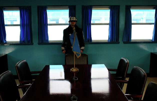 A South Korean soldier stands inside the Military Armistice Committee meeting room at the border village of Panmunjom (DMZ) that separates the two Koreas since the Korean War, in Paju, north of Seoul, South Korea, Tuesday, March 19, 2013. The United States is flying nuclear-capable B-52 bombers on training missions over South Korea to highlight Washington's commitment to defend an ally amid rising tensions with North Korea, Pentagon officials said Monday.(AP Photo/Lee Jin-man) Photo: Lee Jin-man