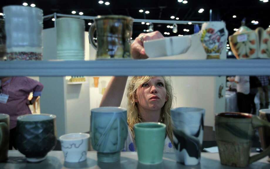 Ainslie Bowling, Fine Art student of University of Mississippi, shops in the ArtStream Nomadic Gallery during the 47th Annual National Council on Education for the Ceramic Arts at George R. Brown Convention Center on Tuesday, March 19, 2013, in Houston. Photo: Mayra Beltran, Houston Chronicle / © 2013 Houston Chronicle