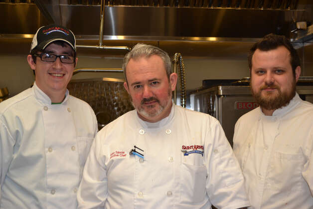 Chef Ryan Savoie, center, is joined in the kitchen by steward Josh Nelson, left and cook Andrew Weigel.