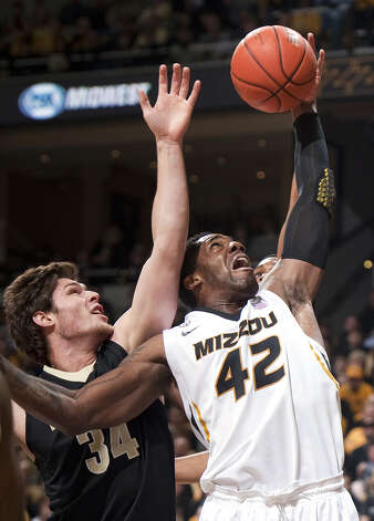 FILE- In this Jan. 26, 2013, file photo, Missouri's Alex Oriakhi, right, pulls down a rebound in front of Vanderbilt's Shelby Moats, left, during the first half of an NCAA college basketball game in Columbia, Mo. The 6-foot-9, 255-pound Oriakhi is averaging close to a double-double and shooting a career best 63 percent for Missouri, which faces Colorado State in the NCAA tournament on Thursday in Lexington, Ky.  (AP Photo/L.G. Patterson, File) Photo: L.G. Patterson, Associated Press / FR23535 AP