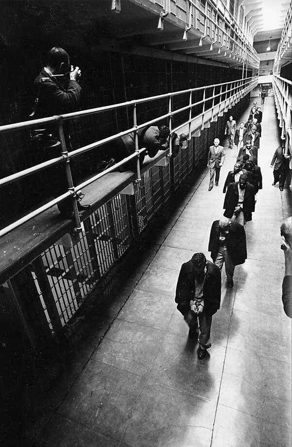 "A line of handcuffed prisoners, the last of the convicts held at Alcatraz prison, walk through the cell block as they are transferred to other prisons from Alcatraz Island on  San Francisco Bay, Calif., March 21, 1963.  Alcatraz, known as ""The Rock,"" was a federal penitentiary for 29 years and a prison for more than a century. (AP Photo) Photo: AP"
