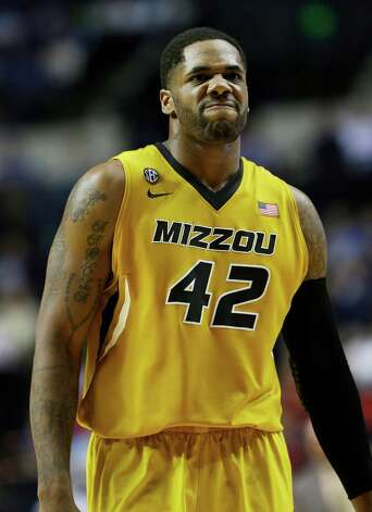 Missouri forward Alex Oriakhi (42) walks down the court after a play against the Mississippi during the second half of an NCAA college basketball game at the Southeastern Conference tournament, Friday, March 15, 2013, in Nashville, Tenn. (AP Photo/Dave Martin) Photo: Dave Martin, Associated Press / AP