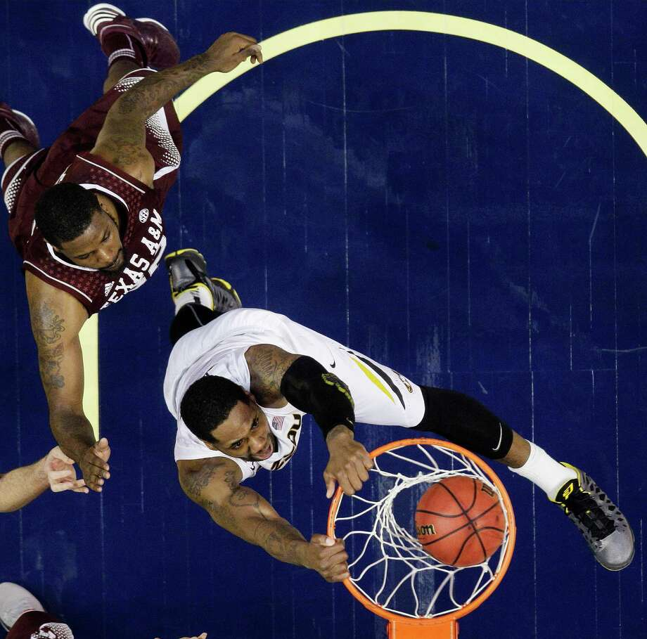 Missouri forward Alex Oriakhi (42) dunks the ball against Texas A&M forward Kourtney Roberson (32) during the first half of an NCAA college basketball game at the Southeastern Conference tournament, Thursday, March 14, 2013, in Nashville, Tenn. (AP Photo/John Bazemore) Photo: John Bazemore, Associated Press / AP