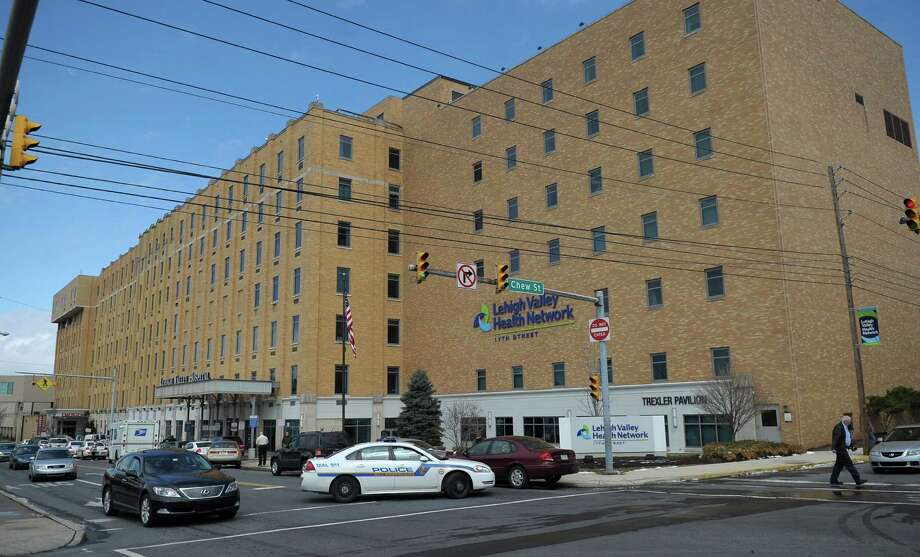 Police are on the scene of a murder-suicide at Lehigh Valley Hospital in Allentown, Pa., Tuesday, March 19, 2013. An elderly man shot and killed his 83-year-old wife in a hospice unit at the hospital, then turned the gun on himself, authorities said. (AP Photo/The Express-Times, Matt Smith) Photo: Matt Smith