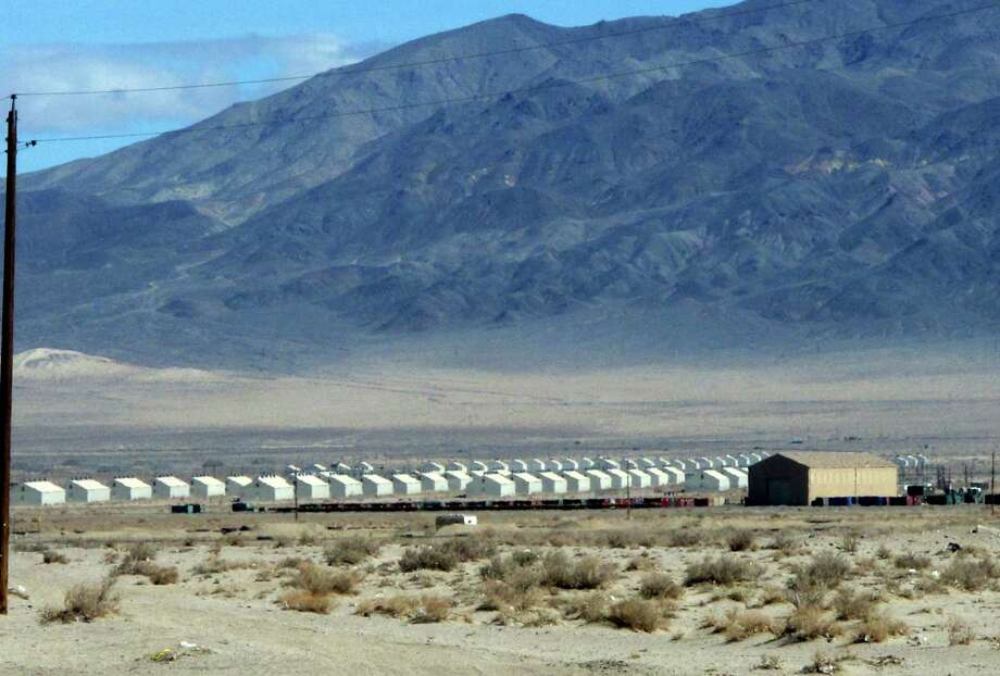 Bunkers are seen at the Hawthorne Army Depot on Tuesday, March 19, 2013, where seven Marines were killed and several others seriously injured in a training accident Monday night, about 150 miles southeast of Reno in Nevada's high desert. (AP Photo/Scott Sonner) Photo: Scott Sonner