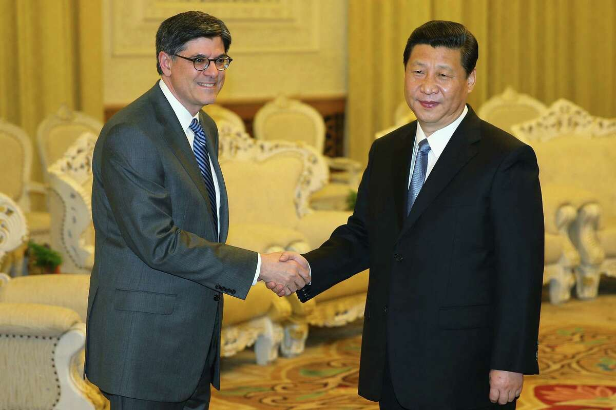 Chinese President Xi Jinping (right), meeting with Treasury Secretary Jacob Lew, hinted at a lowering of expectations about developing a strategic relationship with the United States.