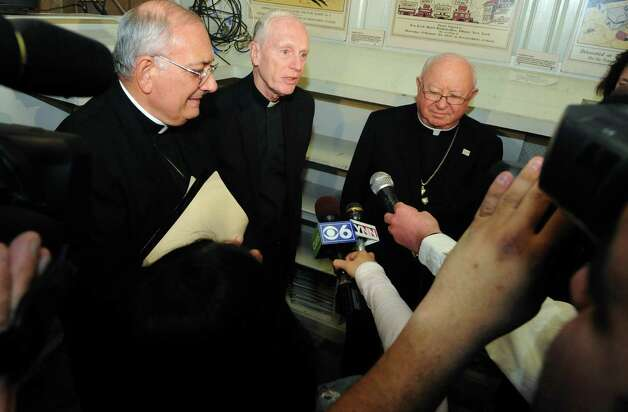 Catholic Bishops Nicholas DiMarzio, Howard Hubbard and William Murphy, left to right, hold a press conference after meeting with Gov. Andrew Cuomo at the Capitol on Tuesday March 19, 2013 in Albany, N.Y. (Michael P. Farrell/Times Union) Photo: Michael P. Farrell