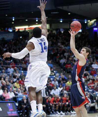 Jordan Gusti (12) of Saint Mary's is guarded by Marcos Knight (14) of Middle Tennessee during the NCAA tournament's First Four. Photo: Barbara J. Perenic, McClatchy-Tribune News Service / MCT