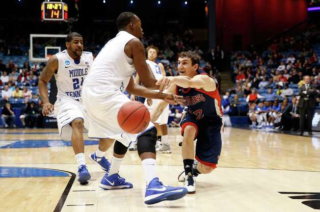 Jordan Giusti #12 of the St. Mary's Gaels passes the ball in the second half against the Middle Tennessee Blue Raiders. Photo: Gregory Shamus, Getty Images / 2013 Getty Images