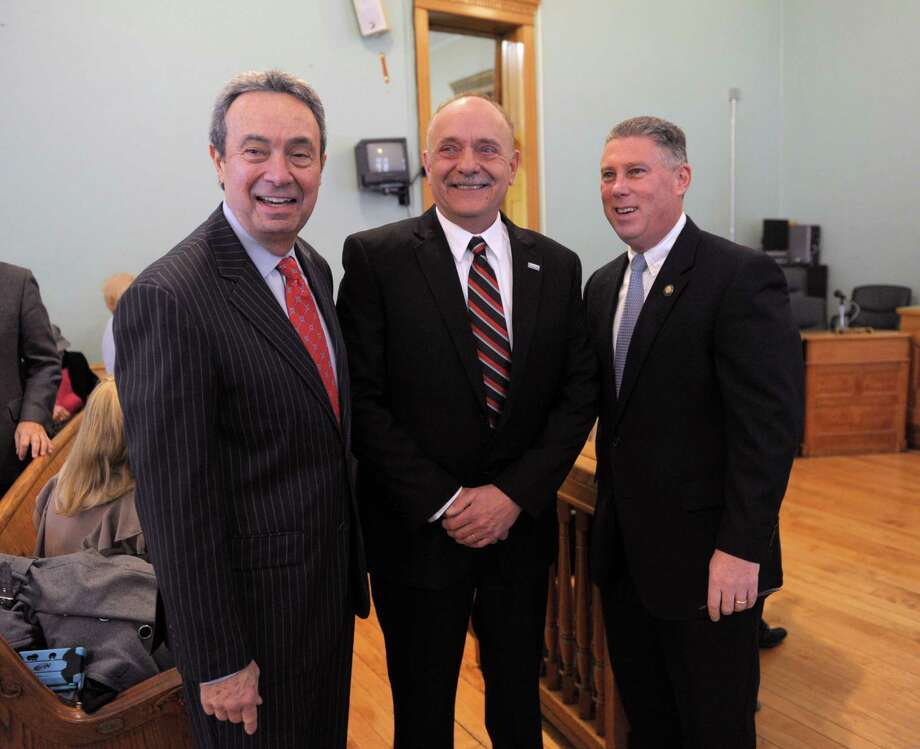 Assemblyman  Ron Canestrari, left, George Primeau, center, and incoming State Assemblyman John McDonald III pose for a photograph before  the swearing in ceremony for George Primeau as the 37th mayor of Cohoes on Monday, Dec. 31, 2012 in the Common Council Chambers in city hall in Cohoes, NY.  Canestrari is a past mayor of Cohoes and McDonald was the previous mayor before leaving the post to run for the State Assembly.   (Paul Buckowski / Times Union) Photo: Paul Buckowski / 00020501A