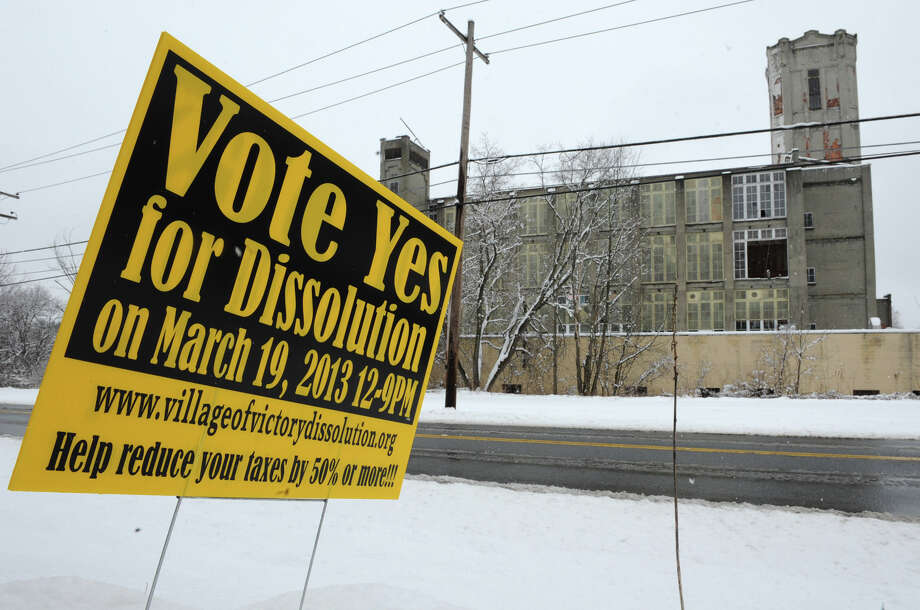 An election sign sticks in the ground for a vote whether or not to dissolve Victory on Tuesday, March 19, 2013 in Victory, N.Y. The Victory Mills are seen in the background. (Lori Van Buren / Times Union) Photo: Lori Van Buren