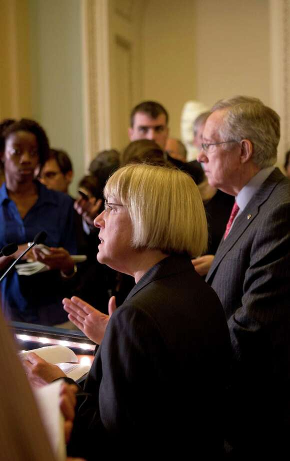 Sen. Patty Murray (D-Wash.) and Senate Majority Leader Harry Reid (D-Nev.) at a news conference on Capitol Hill, in Washington, March 19, 2013. While a Senate proposal expected to pass Tuesday would protect funding for programs like infant nutrition, lawmakers warned of painful cuts for others. (Stephen Crowley/The New York Times) Photo: STEPHEN CROWLEY / NYTNS