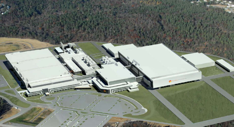 Rendering of what GlobalFoundries Fab 8 in Malta, N.Y., would look like with the new technology and development center, pictured center. At right is what a second manufacturing facility, Fab 8.2, would look like. The existing factory, known as Module 8.1, is pictured at left. On Monday, the Saratoga County Industrial Development Agency approved $387 million in sales tax exemptions for the company, including $253 million for a potential second computer chip factory at the site.(GlobalFoundries)