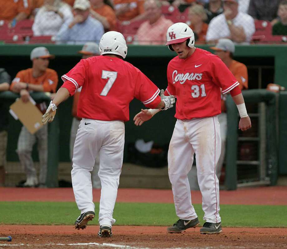 The University of Houston's Jacob Campbell right, cheers on teammate Frankie Ratcliff left, after the pair scored runs against the University of Texas during the second inning. Photo: James Nielsen, Houston Chronicle / © 2013 Houston Chronicle