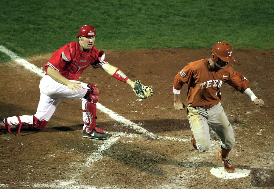 UH catcher Caleb Barker left, watches as UT's Ben Johnson is called safe at home plate during the sixth inning of college baseball game action at the University of Houston's Cougar Field Tuesday, March 19, 2013, in Houston . Photo: James Nielsen, Houston Chronicle / © 2013 Houston Chronicle