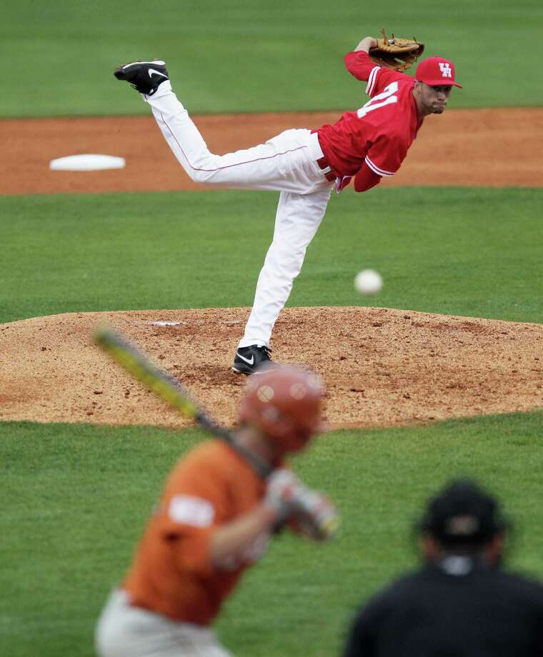 UH pitcher Aaron Garza throws a pitch to Madison Carter of the Longhorns during the second inning of college baseball game action at the University of Houston's Cougar Field Tuesday, March 19, 2013, in Houston . Photo: James Nielsen, Houston Chronicle / © 2013 Houston Chronicle