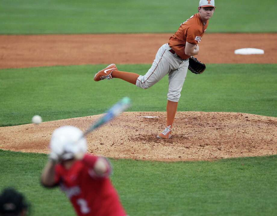 Texas' Chad Hollingsworth throws a pitch to the Josh Vidales of UH during the second inning. Photo: James Nielsen, Houston Chronicle / © 2013 Houston Chronicle