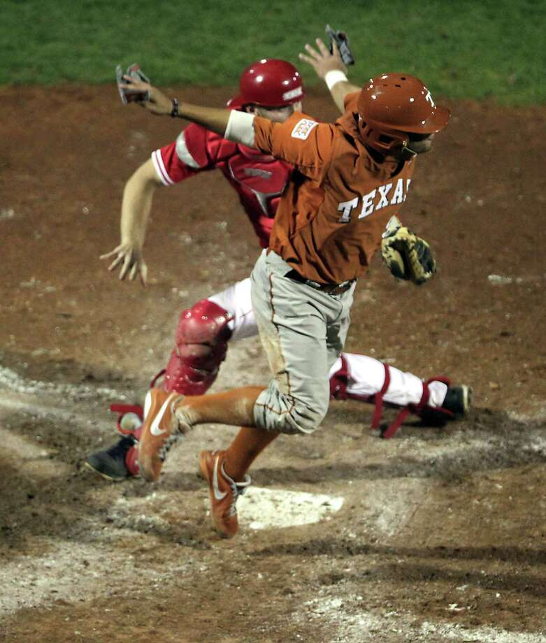 UH catcher Caleb Barker watches as Texas' C.J. Hinojosa is called safe at home plate during the sixth inning. Photo: James Nielsen, Houston Chronicle / © 2013 Houston Chronicle