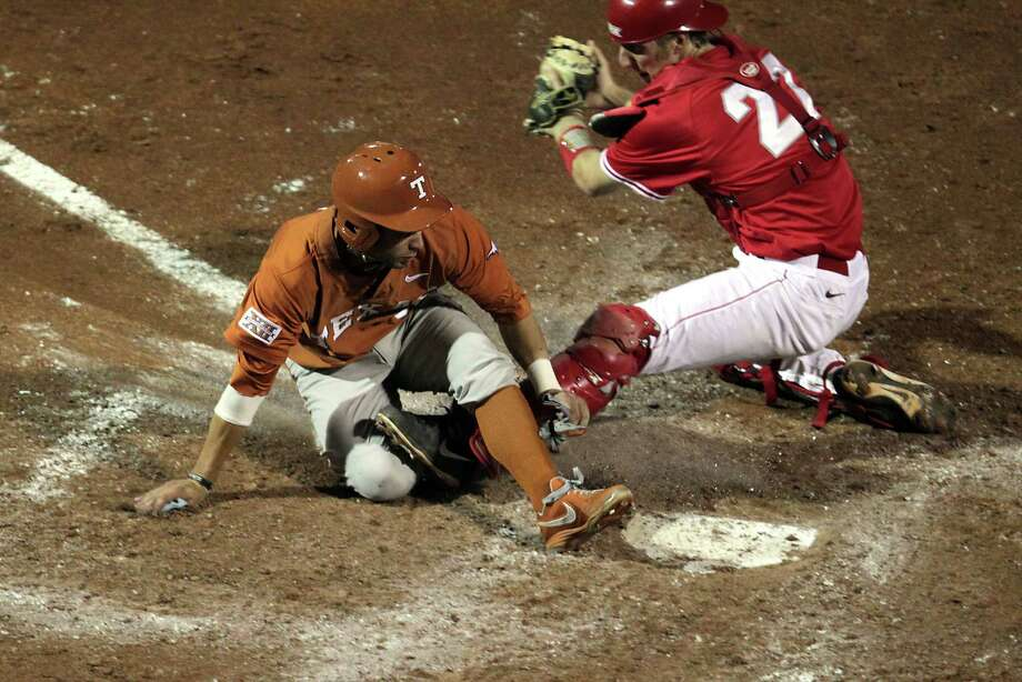 UH catcher Caleb Barker left, watches as C.J. Hinojosa of the Longhorns is called safe at home plate during the sixth inning. Photo: James Nielsen, Houston Chronicle / © 2013 Houston Chronicle