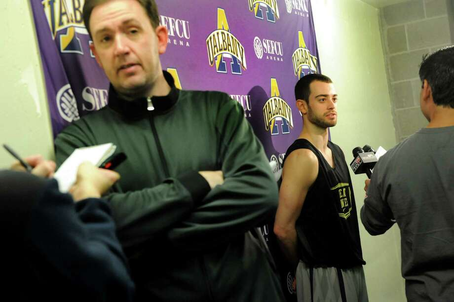 UAlbany's coach Will Brown, left, and player Jacob Iati, center, talk with the media about the upcoming trip to the NCAA Men's Basketball Tournament on Tuesday, March 19, 2013, at UAlbany in Albany , N.Y. (Cindy Schultz / Times Union) Photo: Cindy Schultz / 00021630A