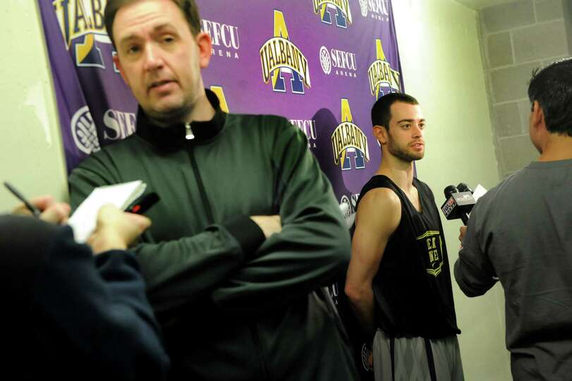 UAlbany's coach Will Brown, left, and player Jacob Iati, center, talk with the media about the upcom