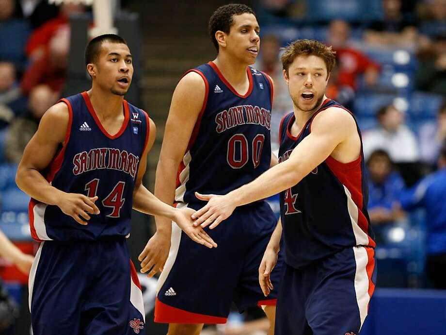 St. Mary's Stephen Holt (left), Brad Waldow and Matthew Dellavedova have a fast turnaround. Photo: Gregory Shamus, Getty Images