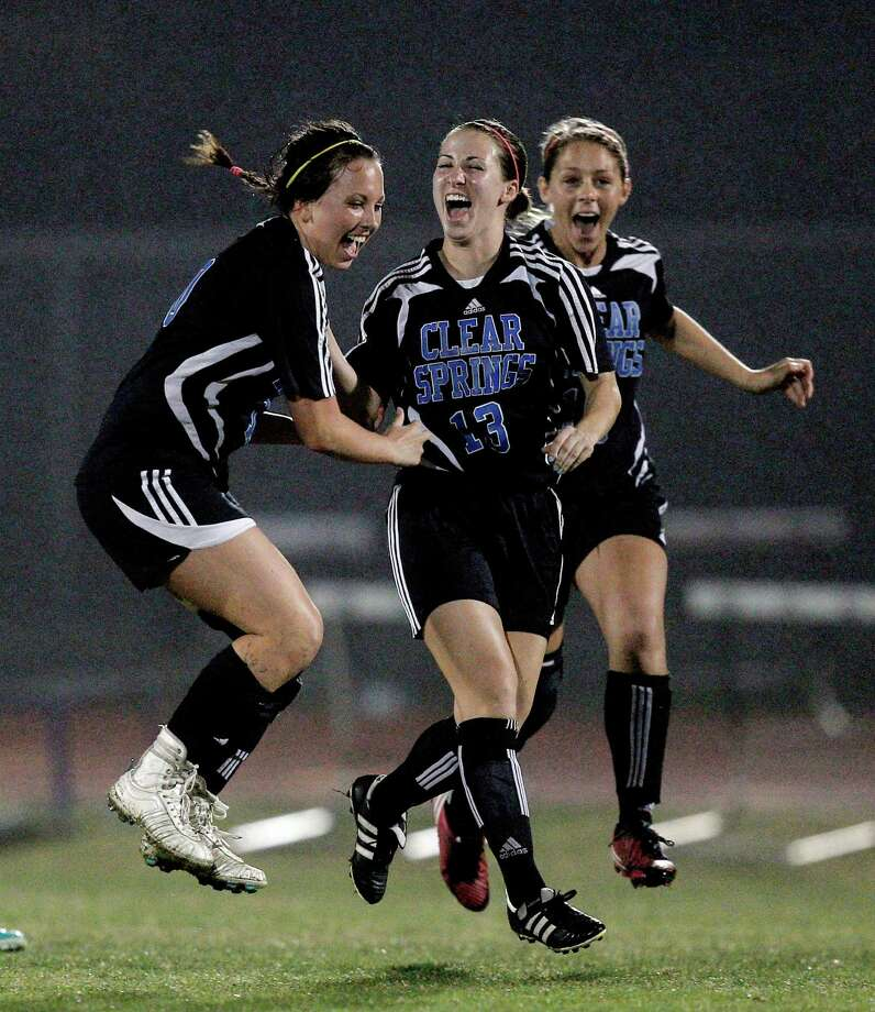 Clear Springs 1, Clear Falls 0Clear Spring's Morgan Crouch, center, along with Delaney Murphy, left and Kelsey Connolly, right celebrate after a score against Clear Falls in the second half. Photo: Bob Levey, Houston Chronicle / ©2013 Bob Levey