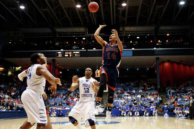 Stephen Holt #14 of the St. Mary's Gaels attempts a shot in the second half against the Middle Tennessee Blue Raiders. Photo: Gregory Shamus, Getty Images / 2013 Getty Images