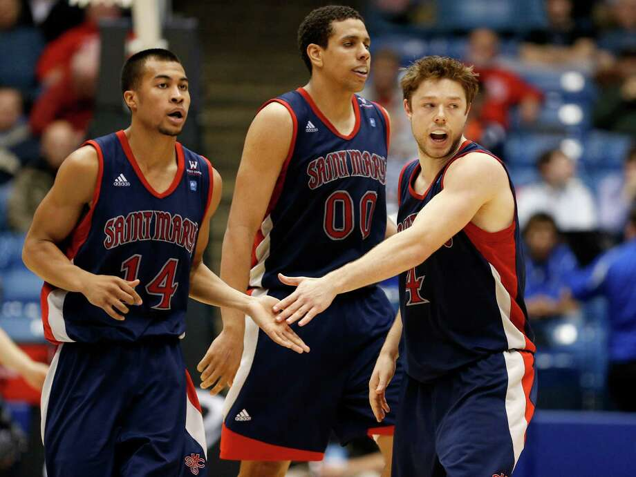 Stephen Holt #14, Brad Waldow #00 and Matthew Dellavedova #4 of the St. Mary's Gaels react after a play in the second half. Photo: Gregory Shamus, Getty Images / 2013 Getty Images