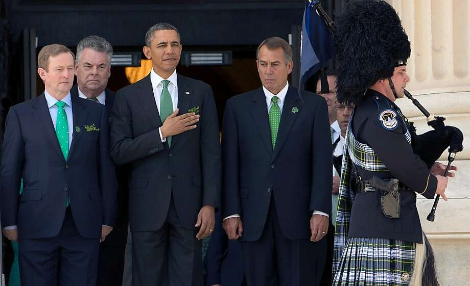 U.S. President Barack Obama (2nd R) is escorted by (L-R) Irish Prime Minister Edna Kenny, Rep. Peter King (R-NY), and U.S. Speaker of the House John Boehner (R-OH) as a bagpiper plays while leaving the U.S. Capitol on March 19, 2013 in Washington, DC. Obama and Kenny attended the annual Friends of Ireland luncheon, which usually coincides with St. Patricks's Day, hosted by the House of Representatives at the U.S. Capitol.  (Photo by Win McNamee/Getty Images) Photo: Win McNamee, Getty Images