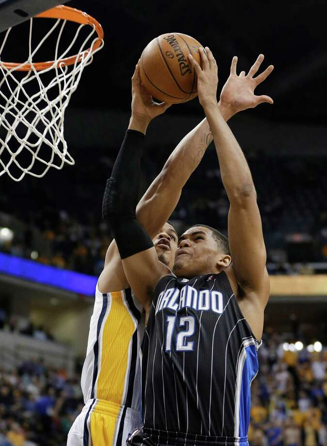 Orlando Magic's Tobias Harris (12) is fouled by Indiana Pacers' Gerald Green as he goes up for a dunk during the first half of an NBA basketball game Tuesday, March 19, 2013, in Indianapolis. (AP Photo/Darron Cummings) Photo: Darron Cummings