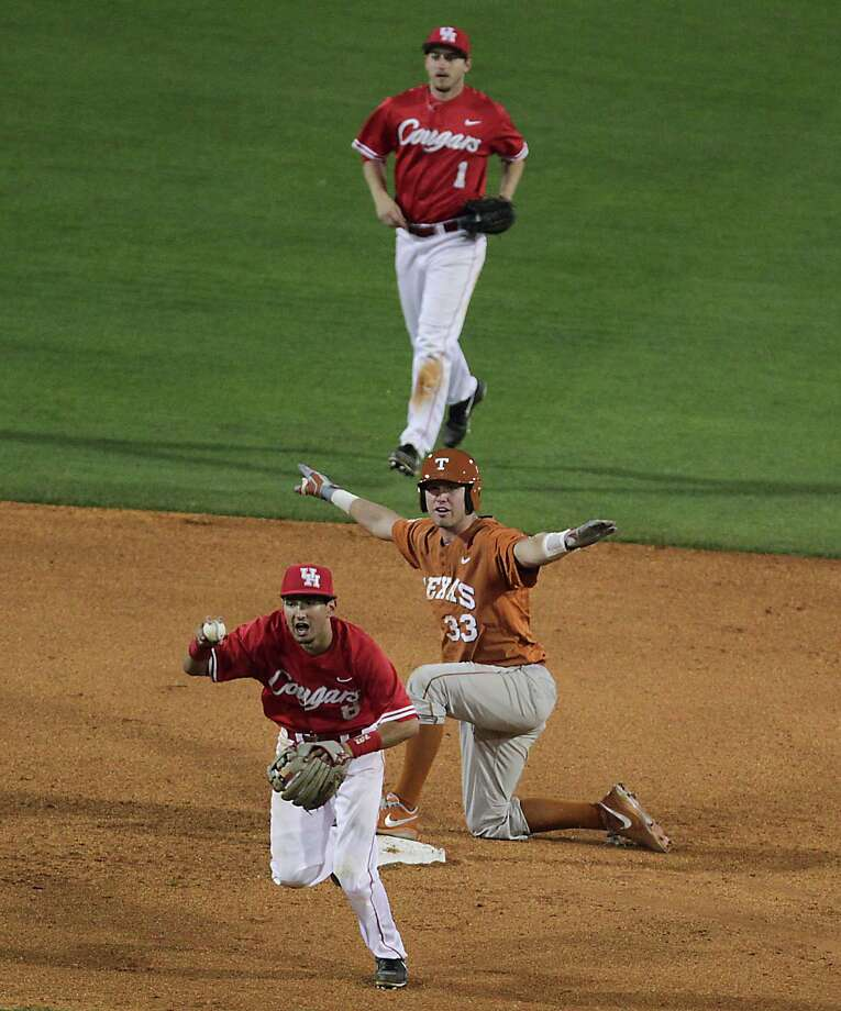 UH's Josh Vidales thinks he's gotten an out at second, but UT's Jeremy Montalbano has the right call. Photo: James Nielsen, Staff / © 2013 Houston Chronicle