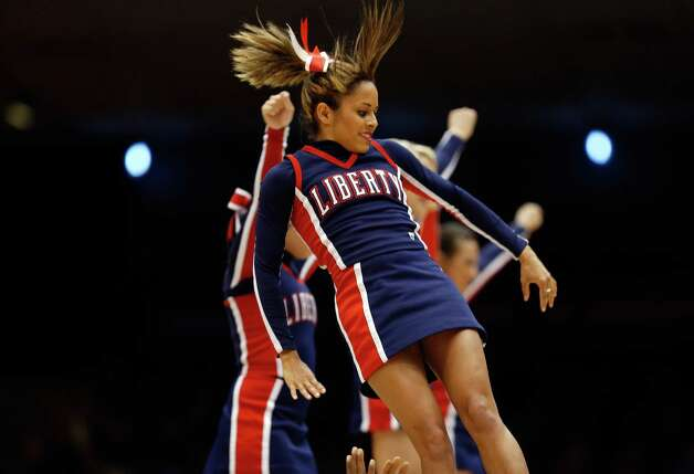 Cheerleaders for the Liberty Flames perform against the North Carolina A&T Aggies during the first round of the 2013 NCAA Men's Basketball Tournament at University of Dayton Arena on March 19, 2013 in Dayton, Ohio. Photo: Gregory Shamus, Getty Images / 2013 Getty Images
