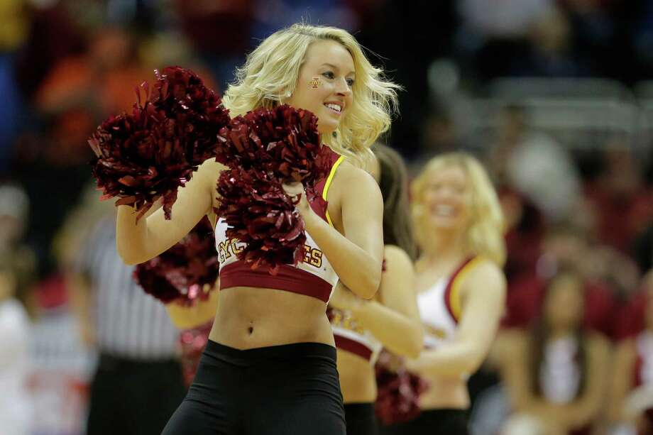 Iowa State cheerleaders perform during the first half an NCAA college basketball game against Oklahoma in the Big 12 men's tournament Thursday, March 14, 2013, in Kansas City, Mo. (AP Photo/Charlie Riedel) Photo: Charlie Riedel, Associated Press / AP