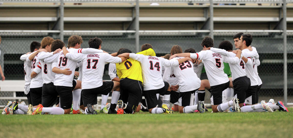 The Churchill soccer team huddles prior to the start of their District 26-5A championship soccer game Tuesday night.