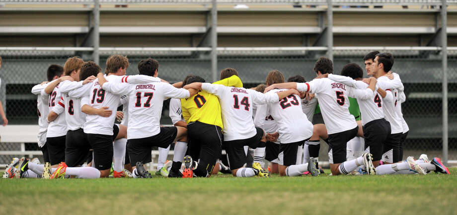 The Churchill soccer team huddles prior to the start of their District 26-5A championship soccer game Tuesday night. Photo: Robin Jerstad, For The San Antonio Express-News