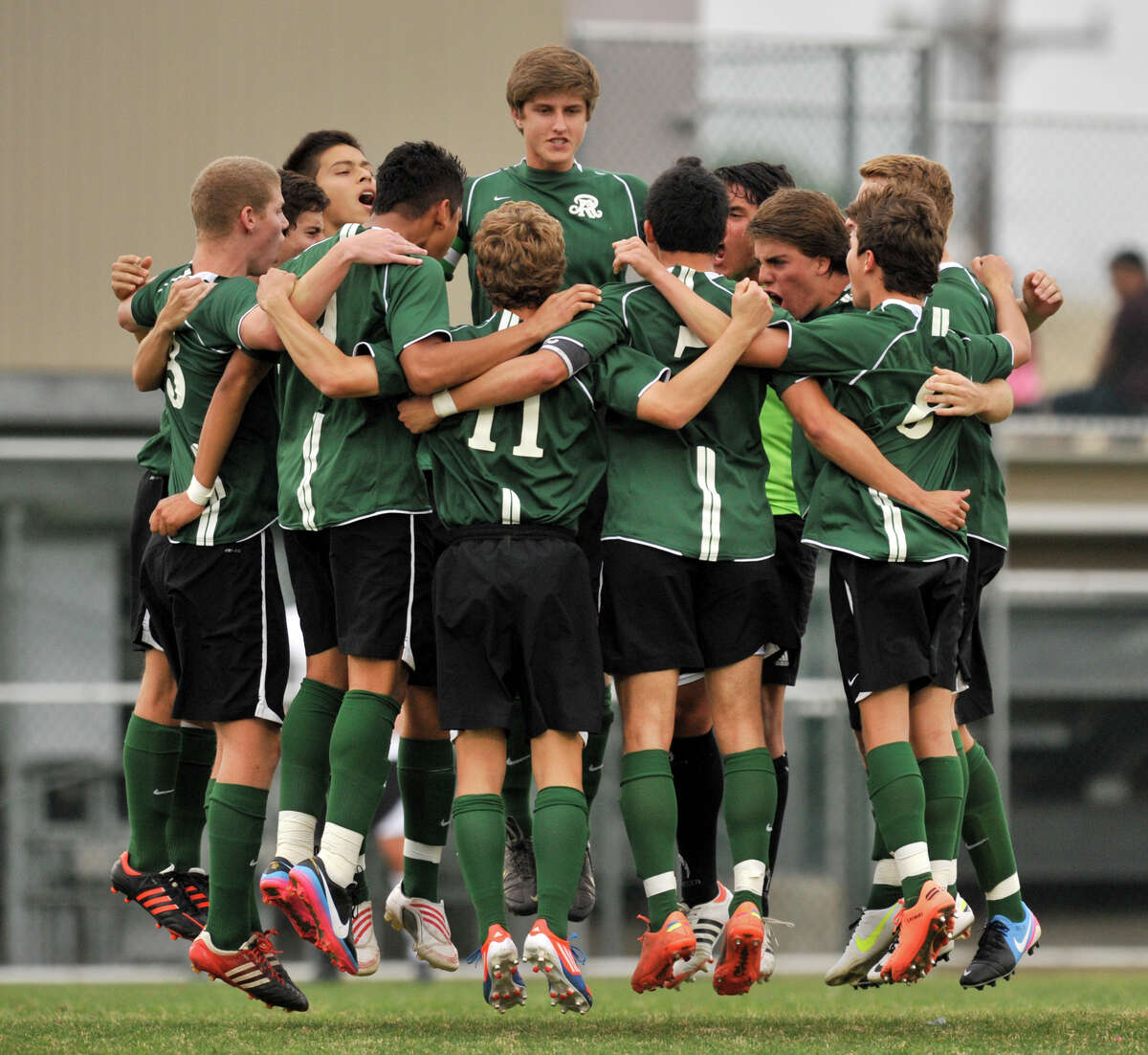 Reagan High School soccer players huddle and jump prior to the start of their District 26-5A championship game versus Churchill Tuesday evening.