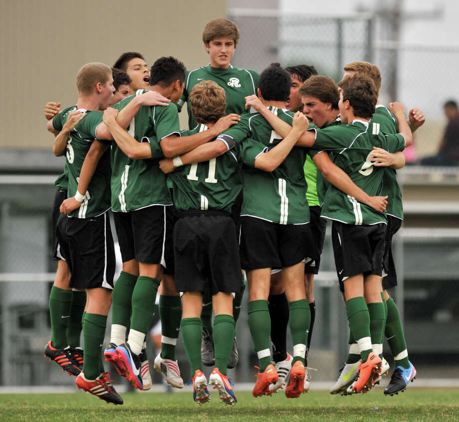 Reagan High School soccer players huddle and jump prior to the start of their District 26-5A championship game versus Churchill Tuesday evening. Photo: Robin Jerstad, For The San Antonio Express-News