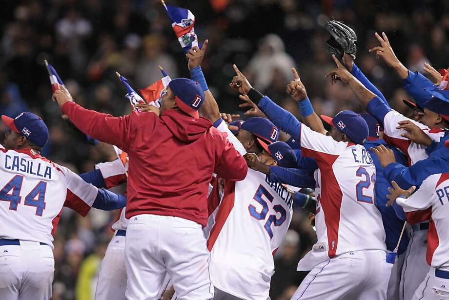 The Dominican Republic team celebrates their 3-0 win over Puerto Rico in the World Baseball Classic championship game in San Francisco on Tuesday, March 19, 2013. Photo: Mathew Sumner, Special To The Chronicle