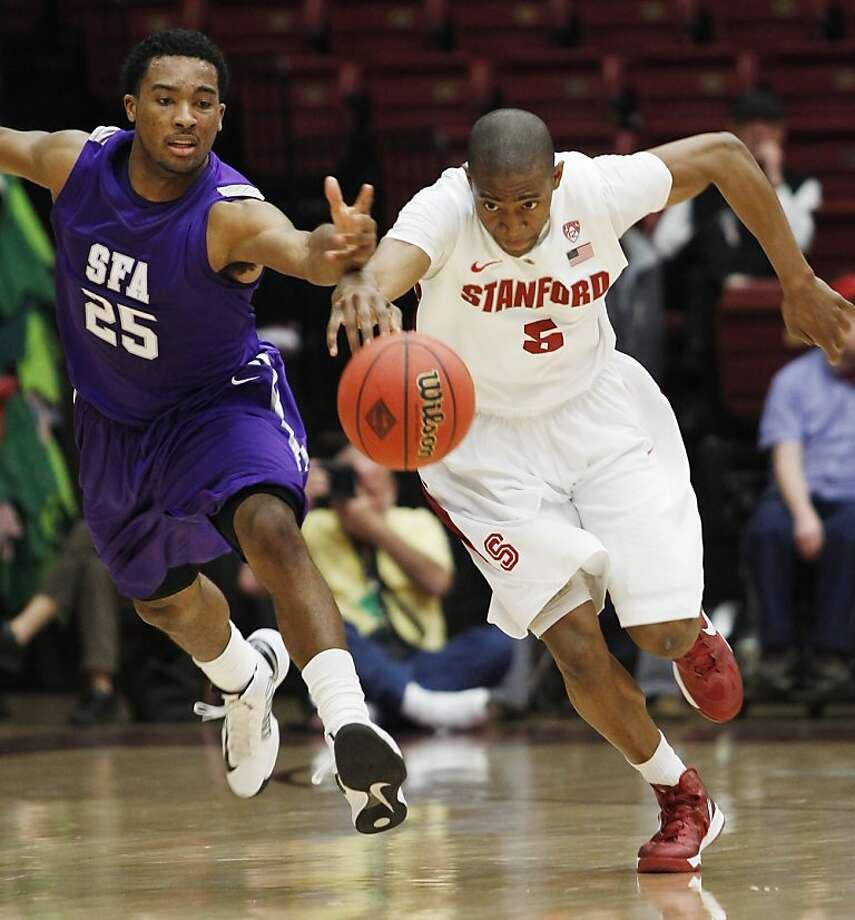 Stephen F. Austin's  Desmond Haymon, left, and Stanford's Chasson Randle chase a loose ball during the second half of a first round NIT college basketball game, Tuesday, March 19, 2013 in Stanford, Calif. Stanford beat SFA 58-57. (Associated Press/George Nikitin) Photo: George Nikitin, Associated Press