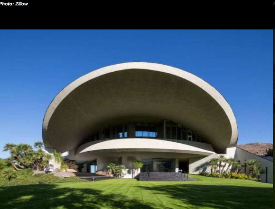 Home is built of concrete, glass and steel with a copper roof