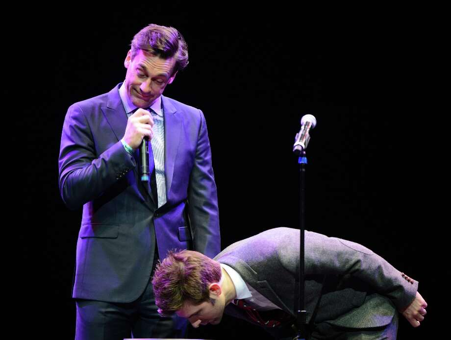 Jon Hamm (left) and Adam Scott perform at the 'WE HATE HURRICANES' comedy benefit in December of 2012 for victims of Superstorm Sandy.  Photo: Michael Kovac / 2012 Getty Images